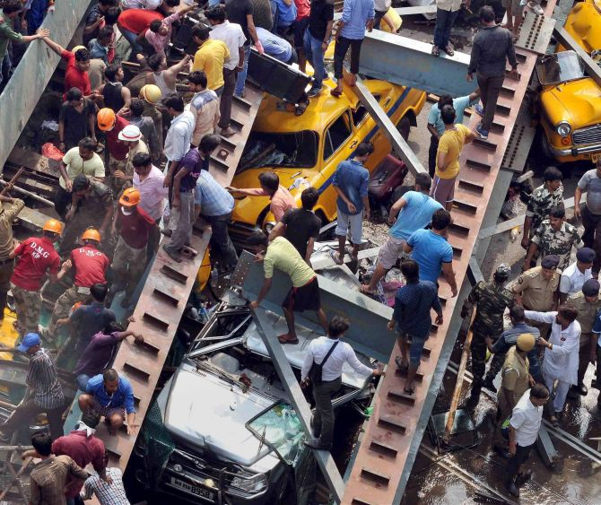 Kolkata: Rescue operations going on after an under-construction flyover collapsed on Vivekananda Road in Kolkata on Thursday. PTI Photo(PTI3_31_2016_000242B)